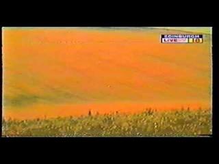 UFO Moving Across Open Field In Daylight