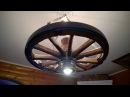 Забор из искусственного булыжника,люстра из старого колеса