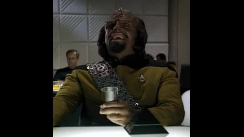 Worf drinking and laughing