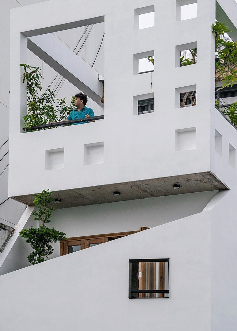 23o5 studio's HVB complex in Vietnam comprises tree-filled voids and bright yellow volumes