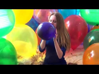 CHICK BLOWING PURPLE BALLOON IN BLOW TO POP